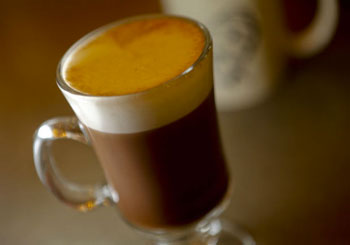 A mocha latte with fresh foamed local milk is made with espresso and unsweetened cocoa.